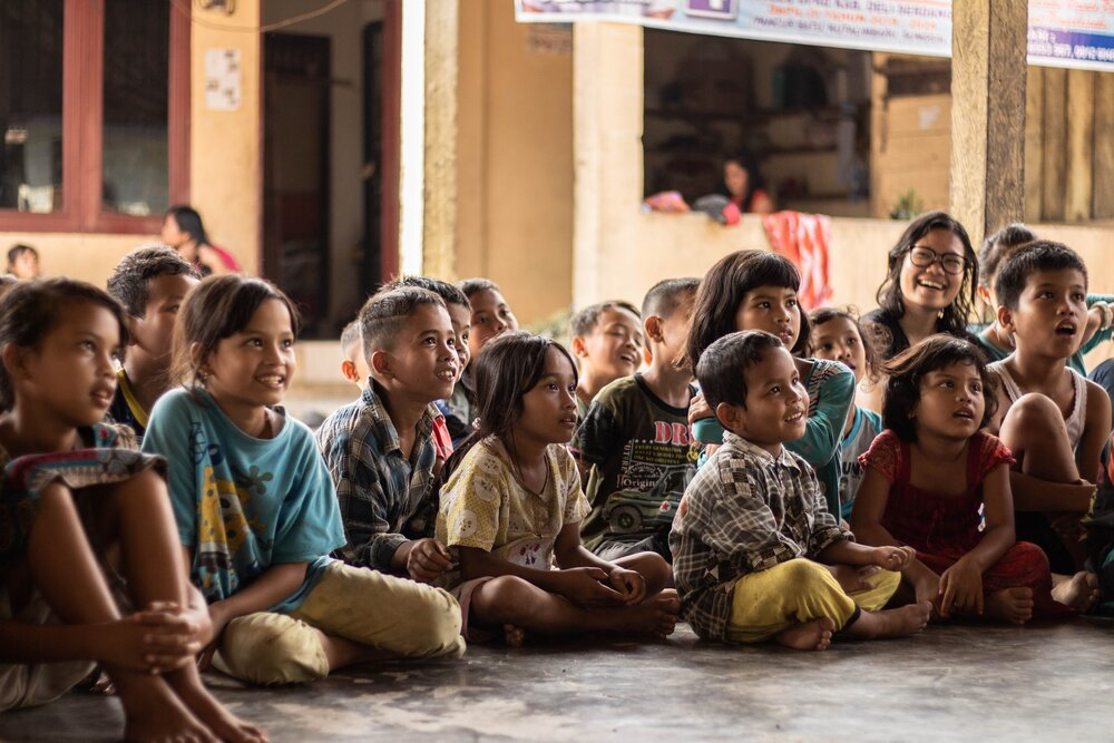 A group of kids sitting down